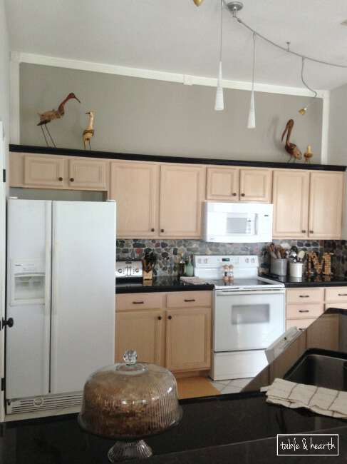 "Stuck with pickled oak cabinets?? Make them seem a little less ""pink"" by painting walls with a cool gray color! www.tableandhearth.com"