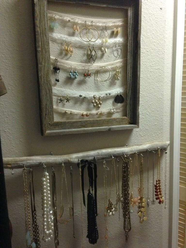 Use materials and supplies you probably already have on hand to make this versatile, cute, and rustic jewelry organization wall. www.tableandhearth.com
