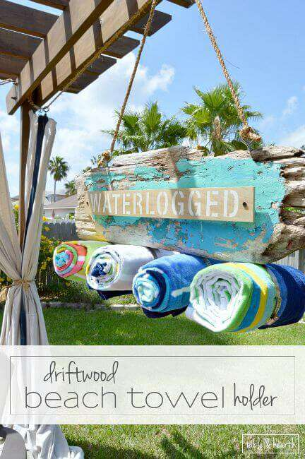 Cute!! This blogger found an awesome chippy paint piece of driftwood and transformed it into a super cute beach towel holder for the backyard!