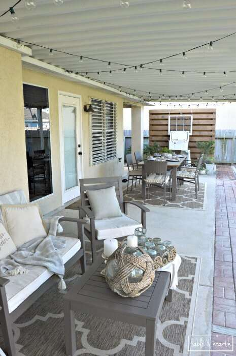 AMAZING! Table & Hearth completely transformed this boring, bare, and beat up patio space into a relaxed, neutral, and weathered coastal-meets-farmhouse space that's perfect for entertianing! Great DIYs and curated decor make it such a beautiful space.