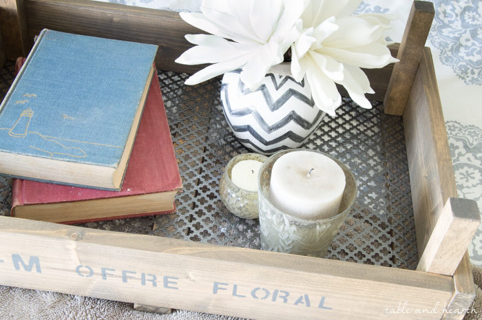 DIY Fixer Upper-Inspired Dutch Tulip Crate - Make use of that scrap wood pile and put together this super simple rustic tray with patterned metal grating. www.tableandhearth.com