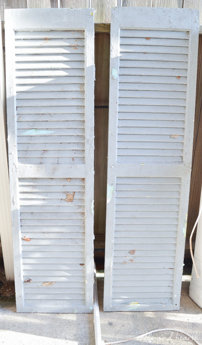 Trash to Treasure! This blogger took a pair of chippy old shutters and turned them into a functional and beautiful rustic wall organizer for her family. www.tableandhearth.com