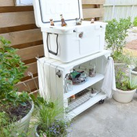 Wow!!! See how this blogger took a beat up old bookcase and transformed it into an adorable farmhouse-inspired rolling bar cart for the patio! www.tableandhearth.com