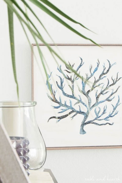 Easy Watercolor Coral Art - This awesome tutorial shows how to use masking fluid to create neutral space in a watercolor, and also how to make a simple frame from wood trim. www.tableandhearth.com