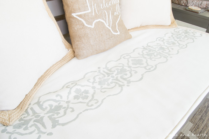 Update a boring cushion with an easy and beautiful stencil!! www.tableandhearth.com