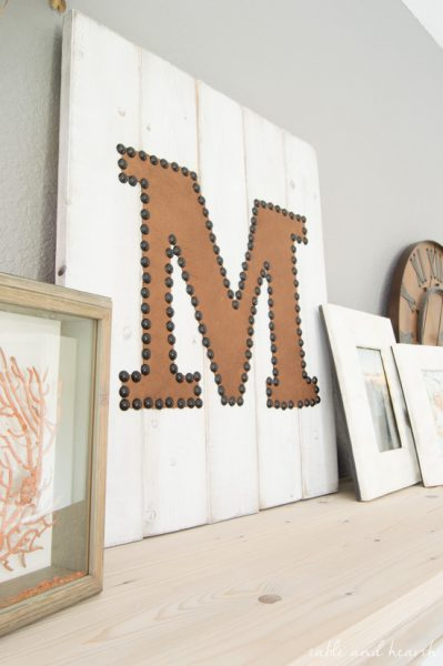 LOVE THIS!! Simple distressed nailhead leather monogram sign. Would be a great housewarming or wedding gift! www.tableandhearth.com