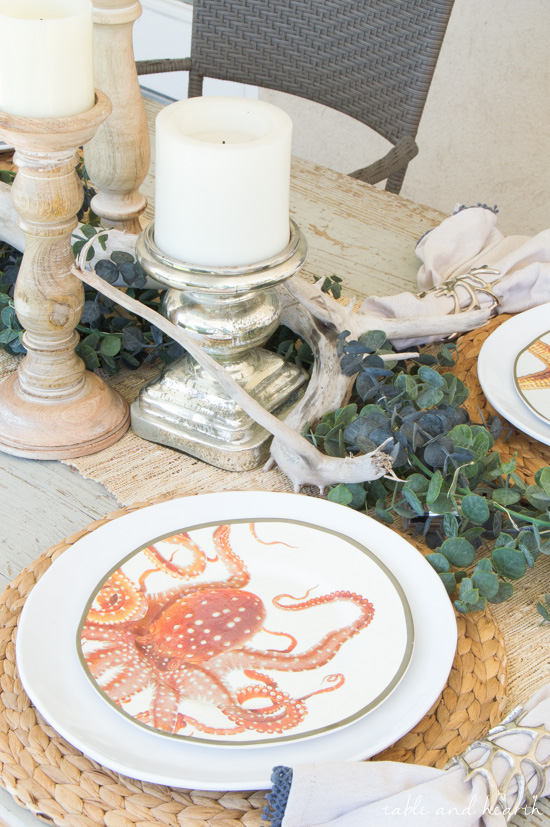 Coastal Summer Patio Decor - Rustic touches and a little whimsy bring this beautiful backyard patio to life for a summer party, night or day! www.tableandhearth.com