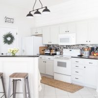 "BEAUTIFUL Gray Kitchen! This kitchen went from pink pickled oak mess to a perfect light gray rustic farmhouse-inspired space full of character. Cabinet color is Sherwin-Williams ""Repose Gray"" www.tableandhearth.com"