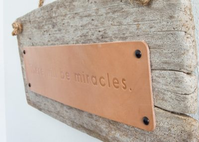 Love this easy rustic hanging driftwood sign with leather!!