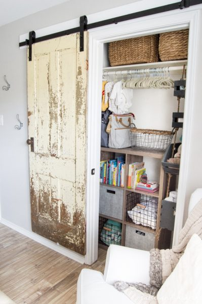 Finally a step-by-step walkthrough on how to install an antique farmhouse barn door! www.tableandhearth.com