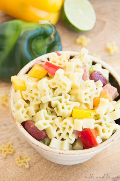 This zesty Texas Pasta Salad with Poblano Lime Vinaigrette is the perfect quick and easy dish for those Texas football parties! #ad #howdyskinner