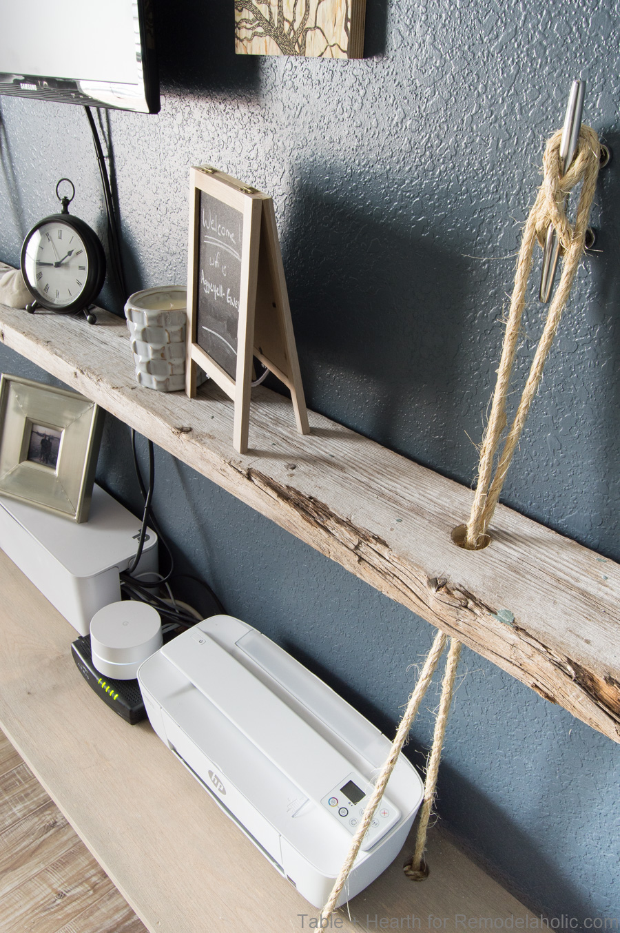 Love this nautical floating shelf with rope!