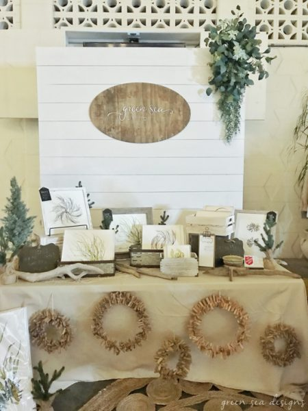 Farmhouse charm for a booth! DIY shiplap backdrop for a vendor booth or craft show! Tutorial at www.tableandhearth.com #backdrop #vendorbooth #craftbooth #boothdecor #shiplap #shiplapwall #craftshow #artbooth