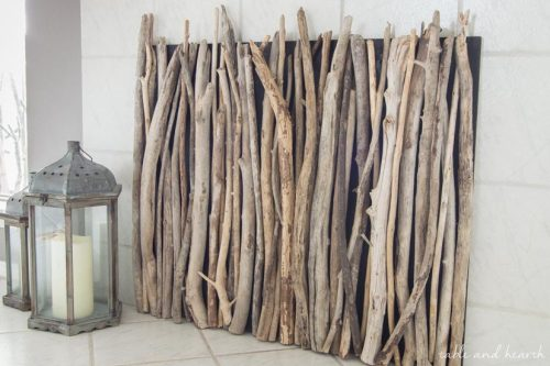 Not using your fireplace? Cover it with this DIY Driftwood Fireplace Cover! #fireplace #fireplacecover #driftwood