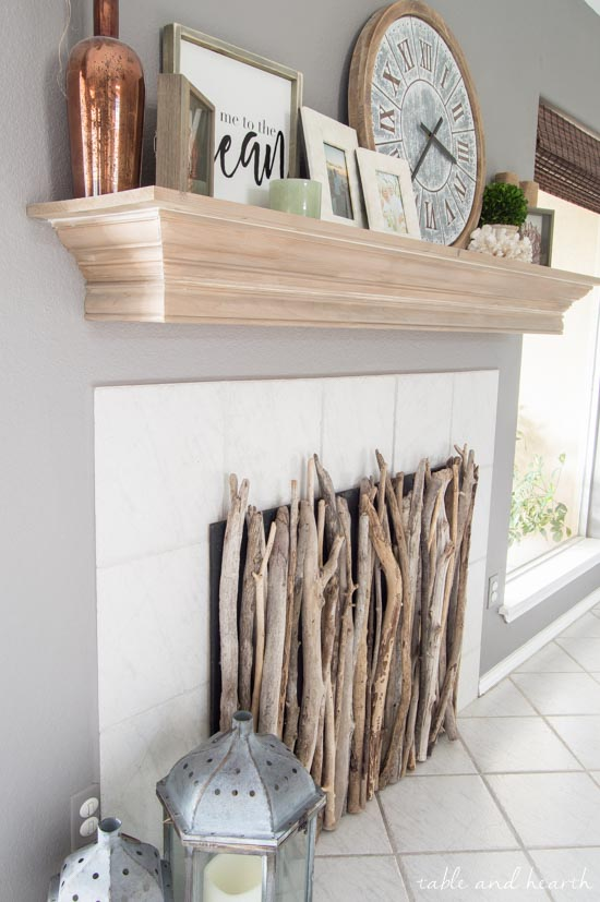 Look at this amazing coastal Driftwood DIY Fireplace Cover! #fireplace #fireplacecover #driftwood