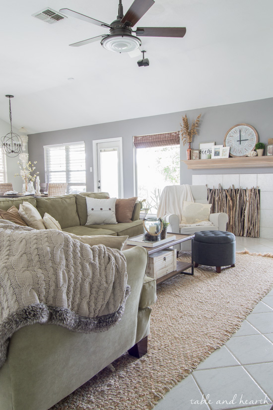 Beautiful coastal farmhouse living room featuring a Driftwood DIY Fireplace Cover! #fireplace #fireplacecover #driftwood