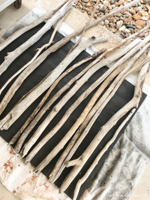 Got lots of driftwood? Make this coastal Driftwood DIY Fireplace Cover! #fireplace #fireplacecover #driftwood