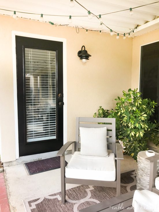 Giving some tired old patio doors a refresh with black exterior door paint from Modern Masters! www.tableandhearth.com #modernmasters #patiodoors #doorpaint #blackdoors